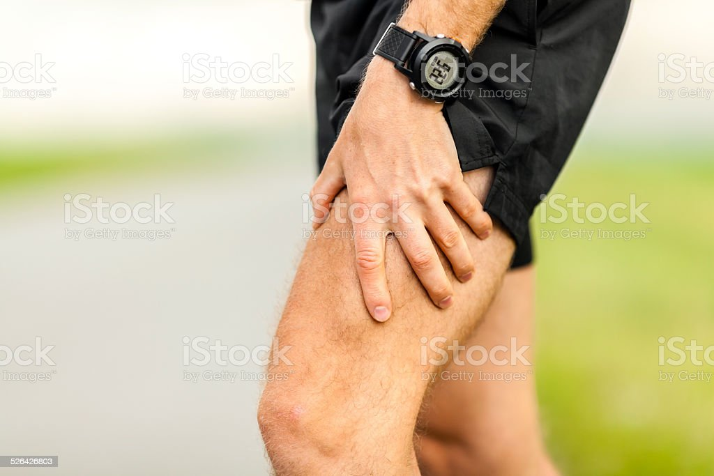 Physical injury, runner muscle pain stock photo