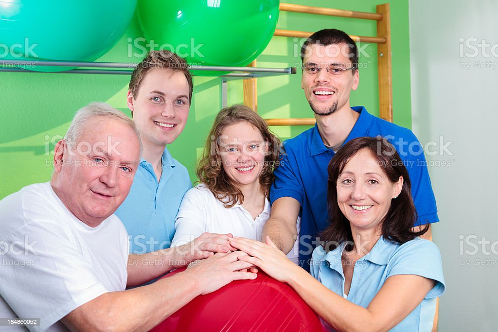 Physical Therapist and Patients standing together stock photo