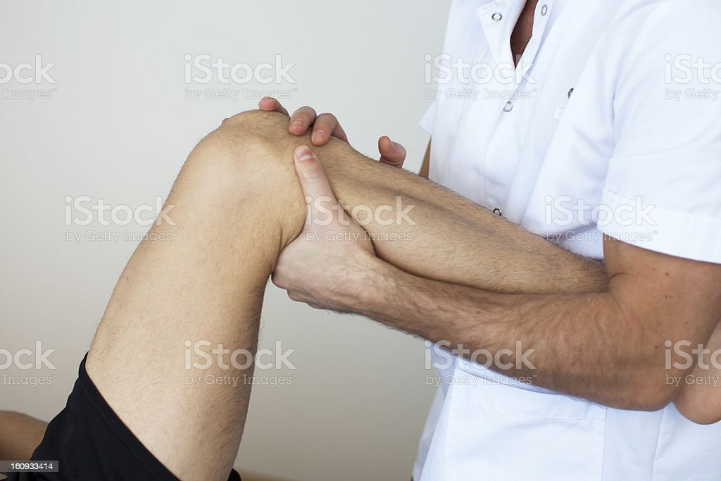 physical therapist applying myofascial therapy stock photo