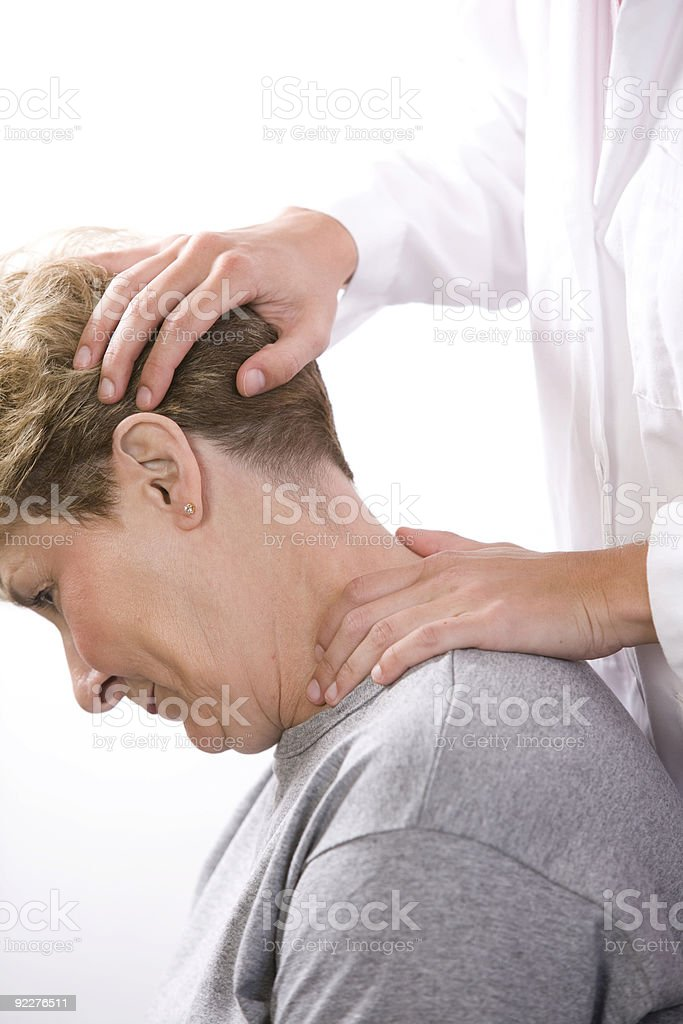 physical therapist examines the neck royalty-free stock photo