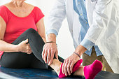 Physical Therapist Examining and Ankle Injury