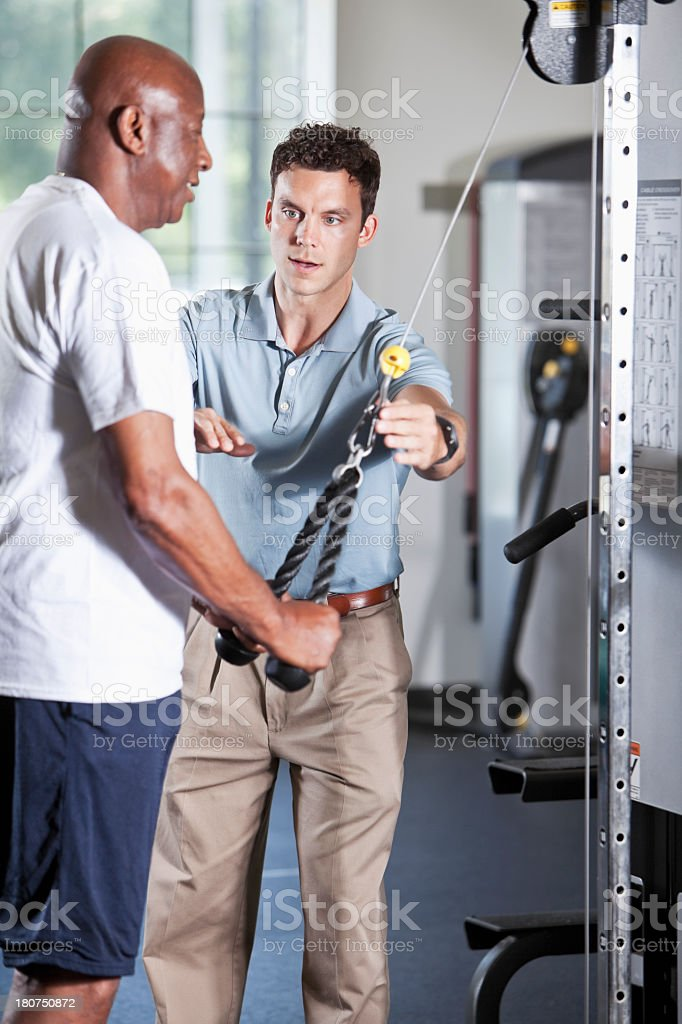 Physical therapist helping African American patient royalty-free stock photo