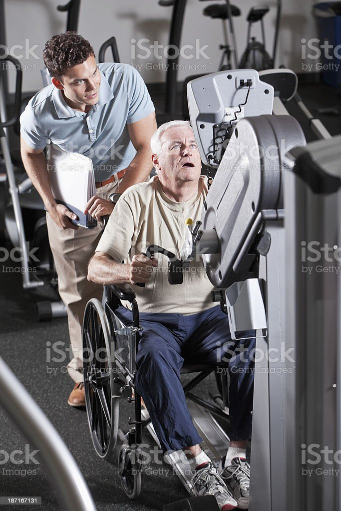 Physical therapist helping patient royalty-free stock photo