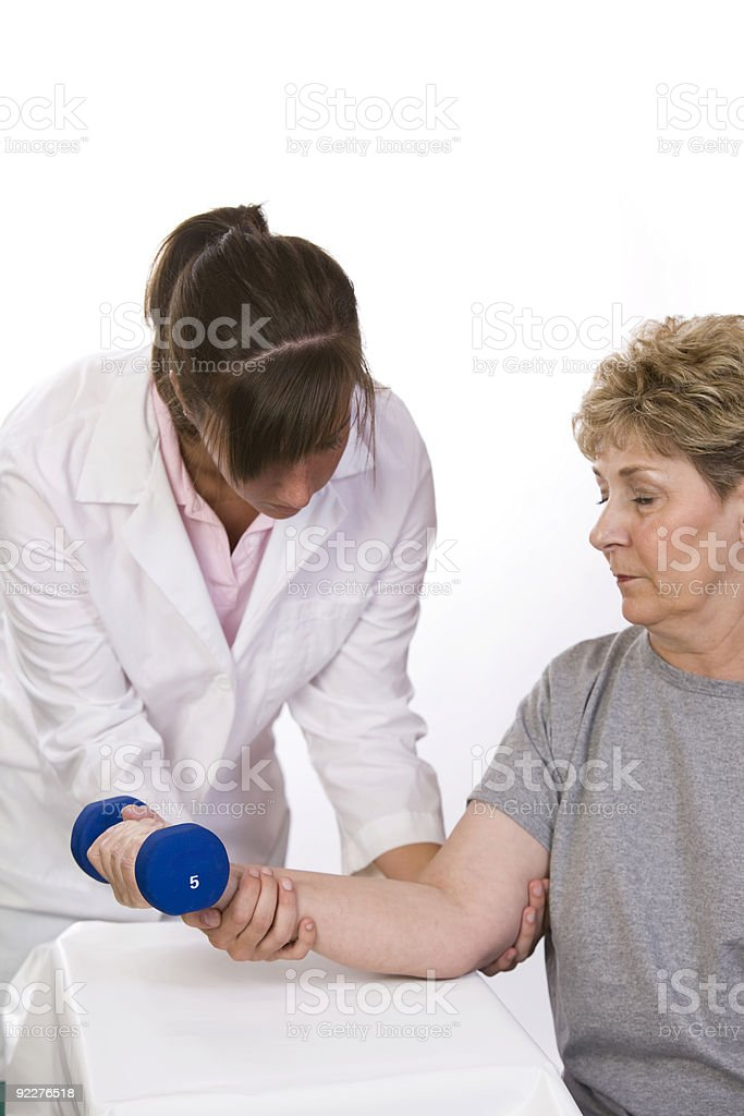 Physical therapist helps a patient royalty-free stock photo
