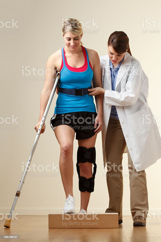 Physical therapist instructing patient with curb training stock photo