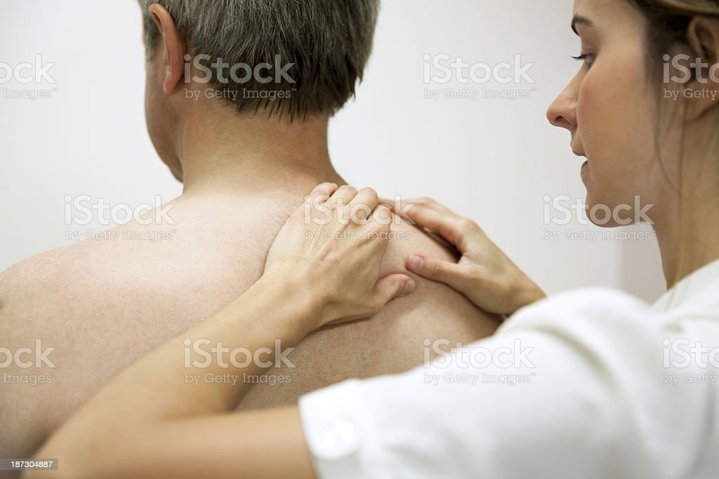 Physical Therapist massaging a patient's back royalty-free stock photo