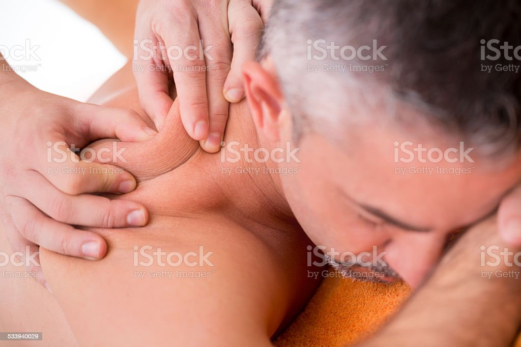 physical therapist massaging shoulder of patient stock photo