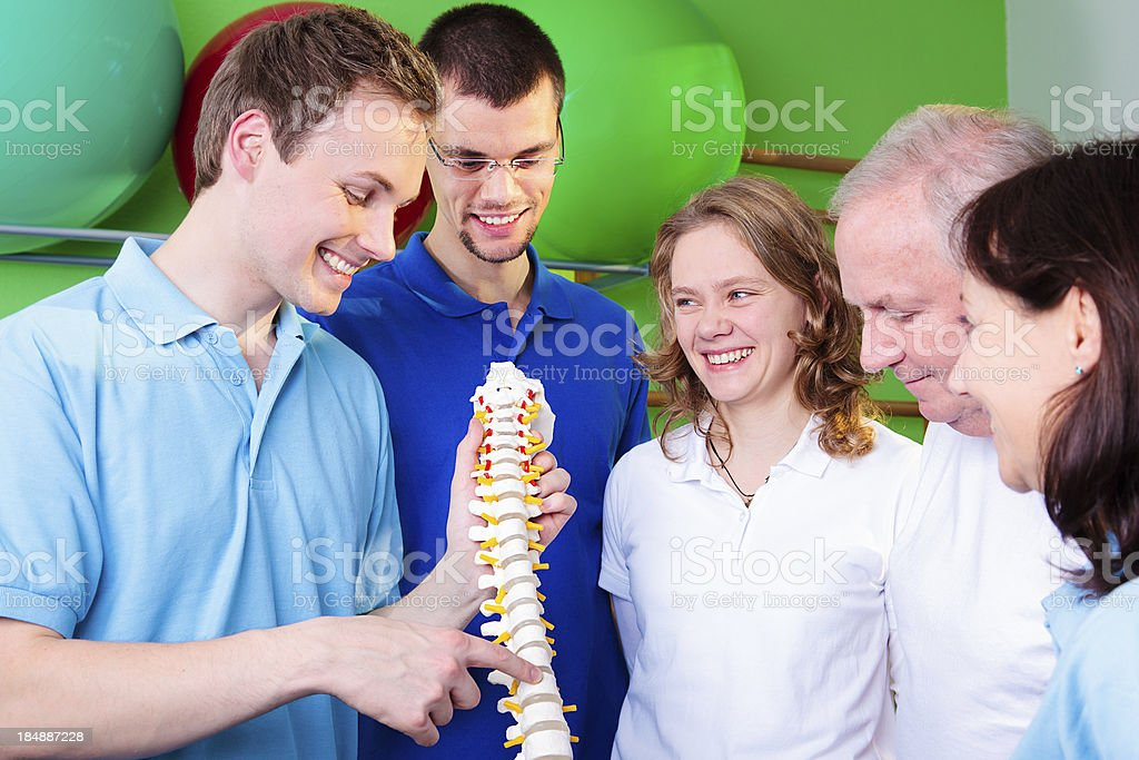 Physical Therapist, Patient and Students standing together stock photo