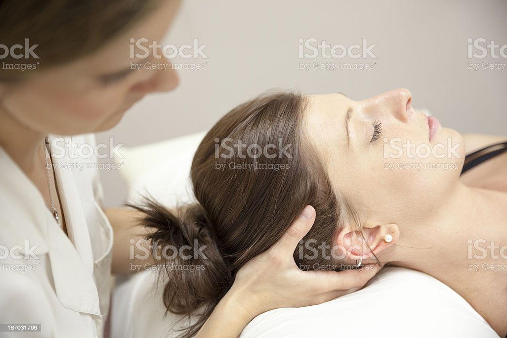 Physical Therapist Series: neck massage stock photo