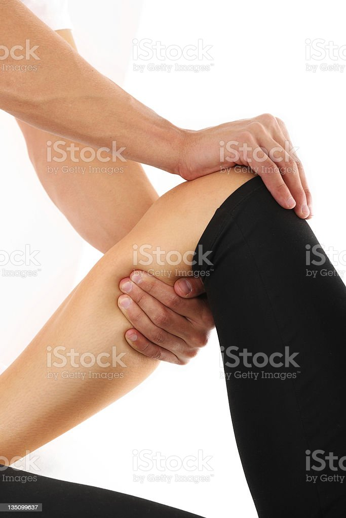 Physical therapist stretching a patient's knee royalty-free stock photo