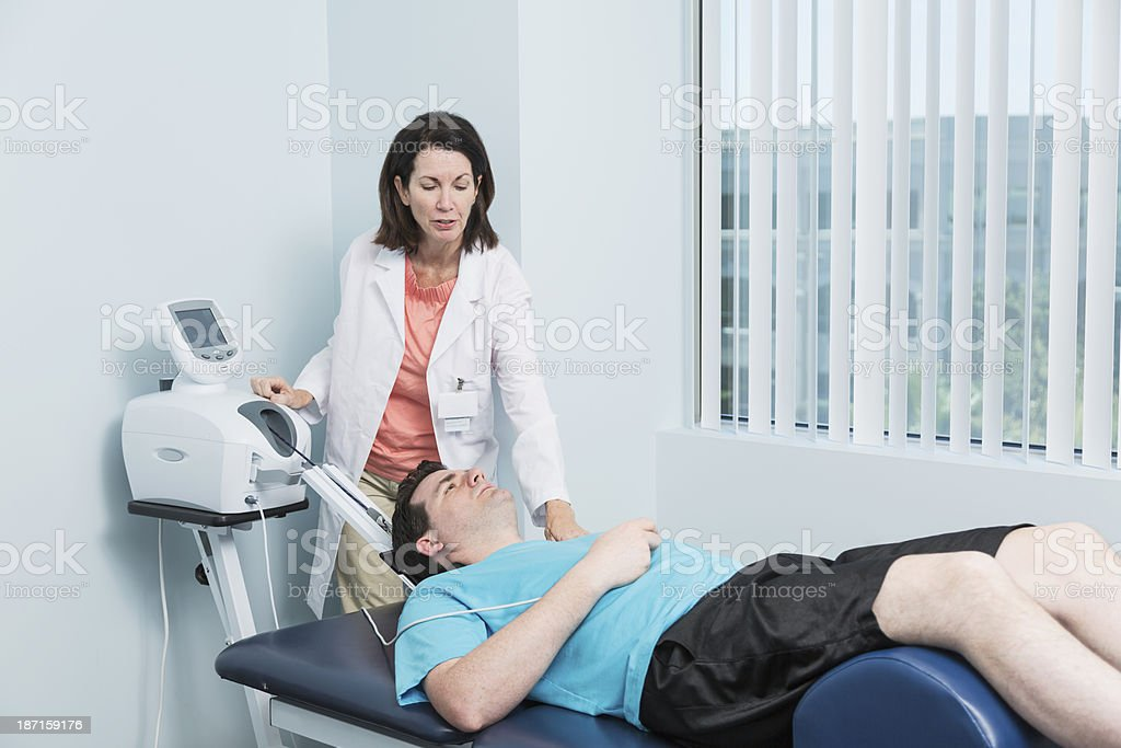 Physical therapist with patient royalty-free stock photo