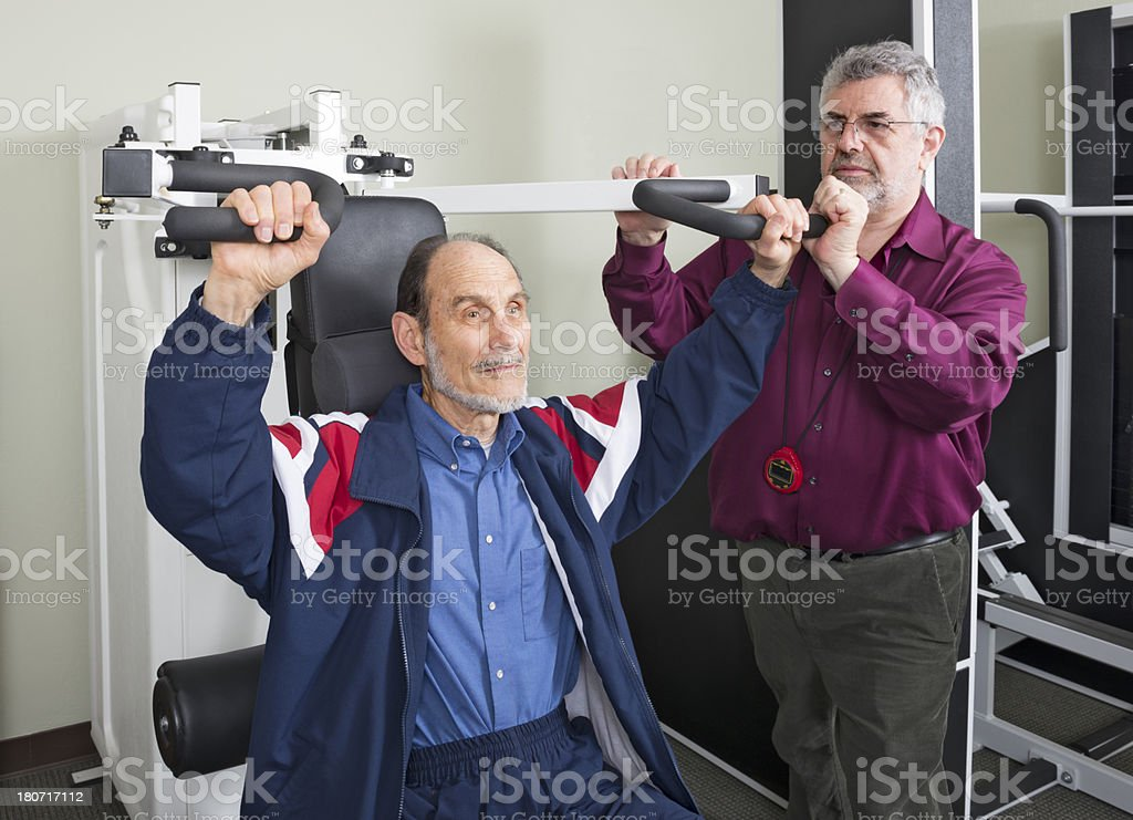 Physical Therapist With Senior Man Doing Arm Exercises stock photo