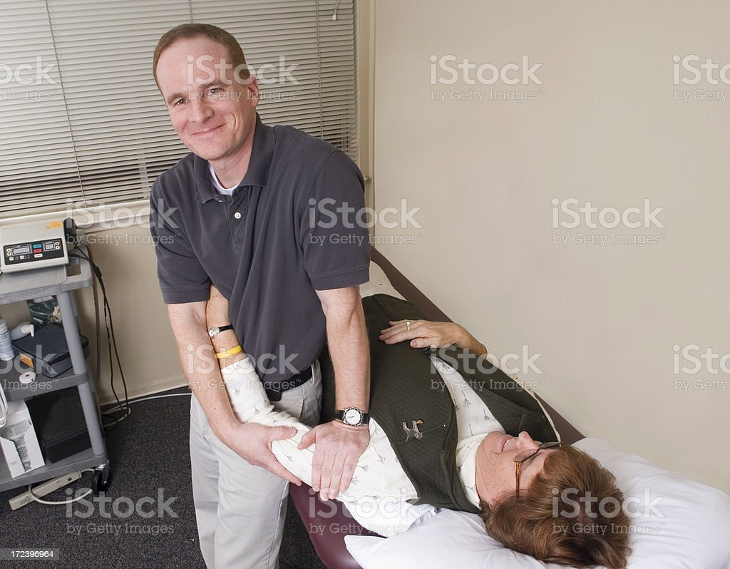Physical Therapist Working On Shoulder royalty-free stock photo