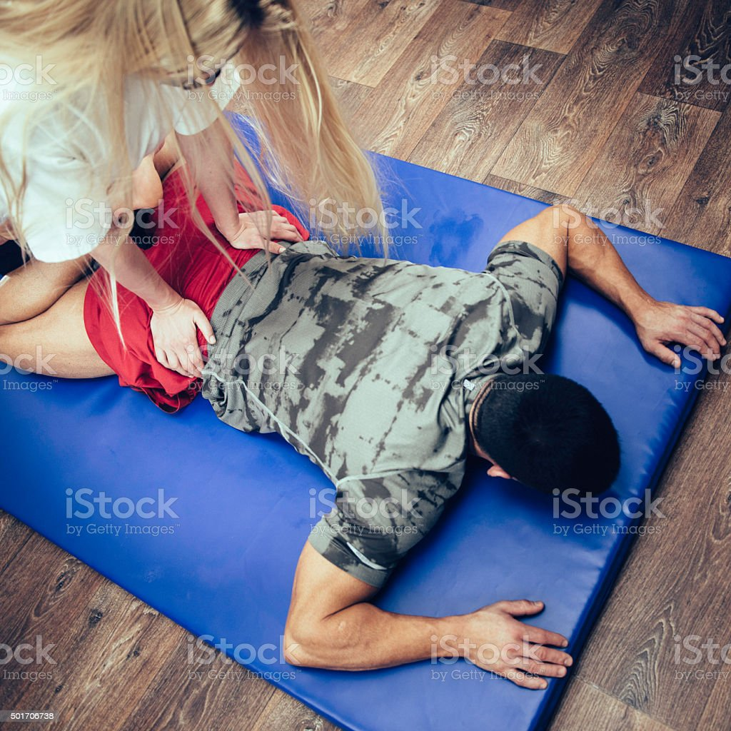 Physical therapist working with athlete stock photo