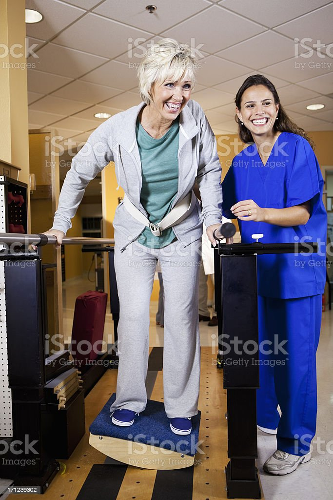 Physical therapist working with patient stock photo