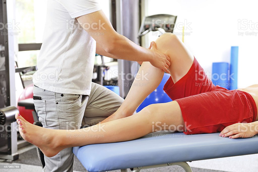 Physical therapy - knee massage stock photo