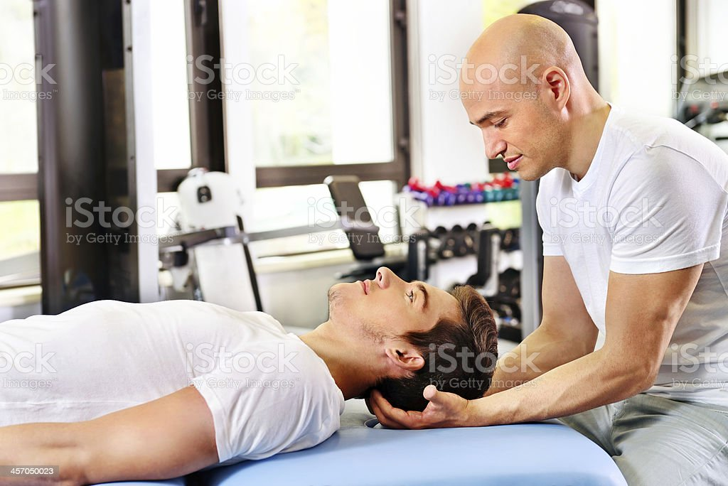 Physical therapy - scalp massage stock photo