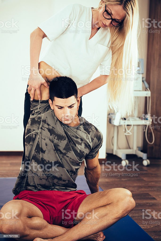 Physical therapy shoulder exercise stock photo