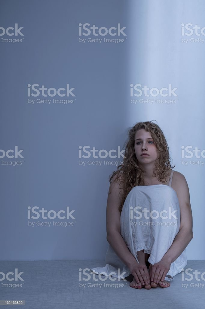 Physically abused girl stock photo