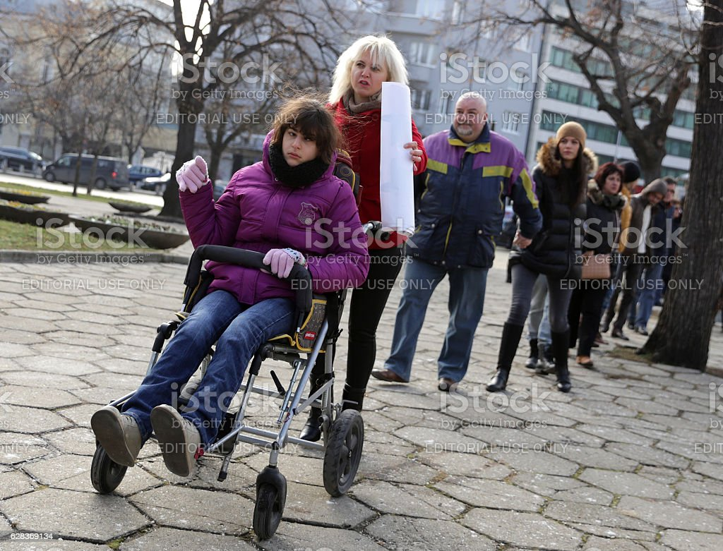 Physically and mentally disabled at a protest stock photo