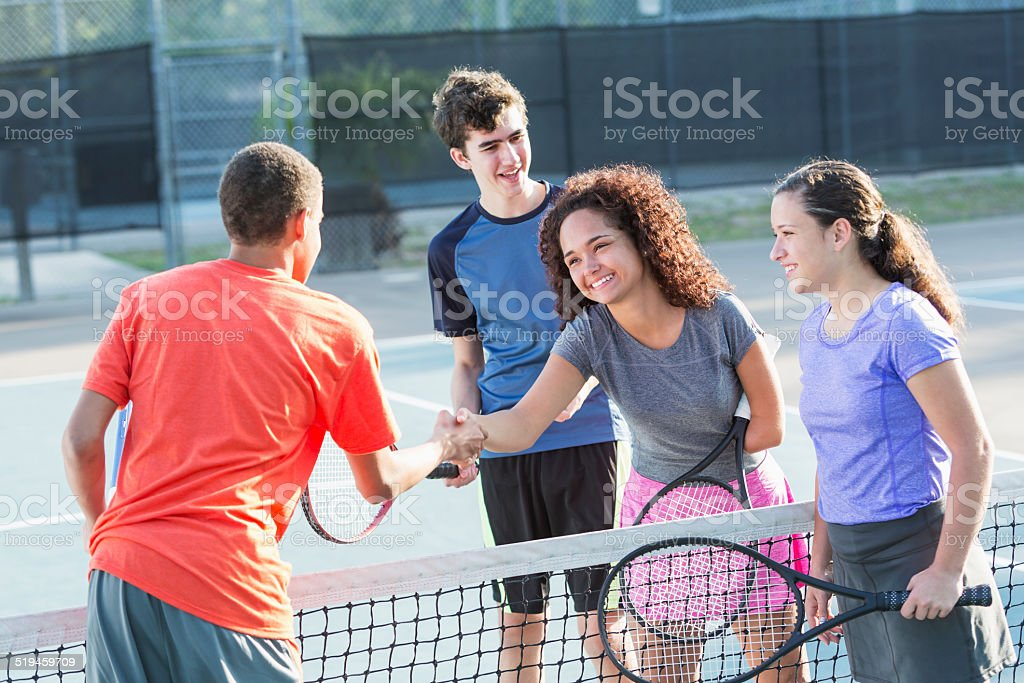 Physically challenged teenage girl playing tennis stock photo