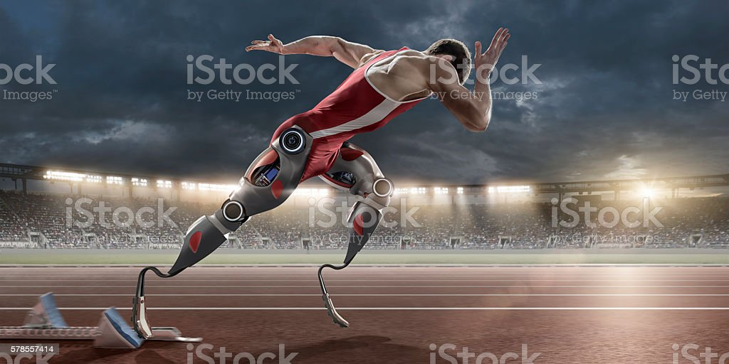 Physically Disabled Athlete Sprinting From Blocks With Artificial Robotic Legs stock photo