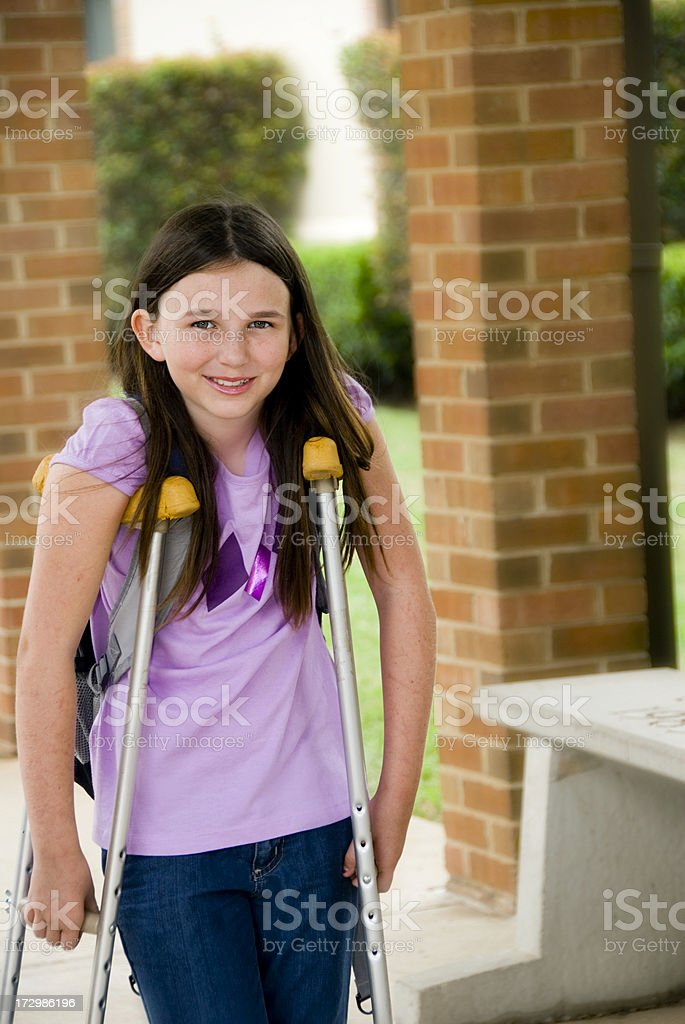 Physically impaired girl on crutches. royalty-free stock photo