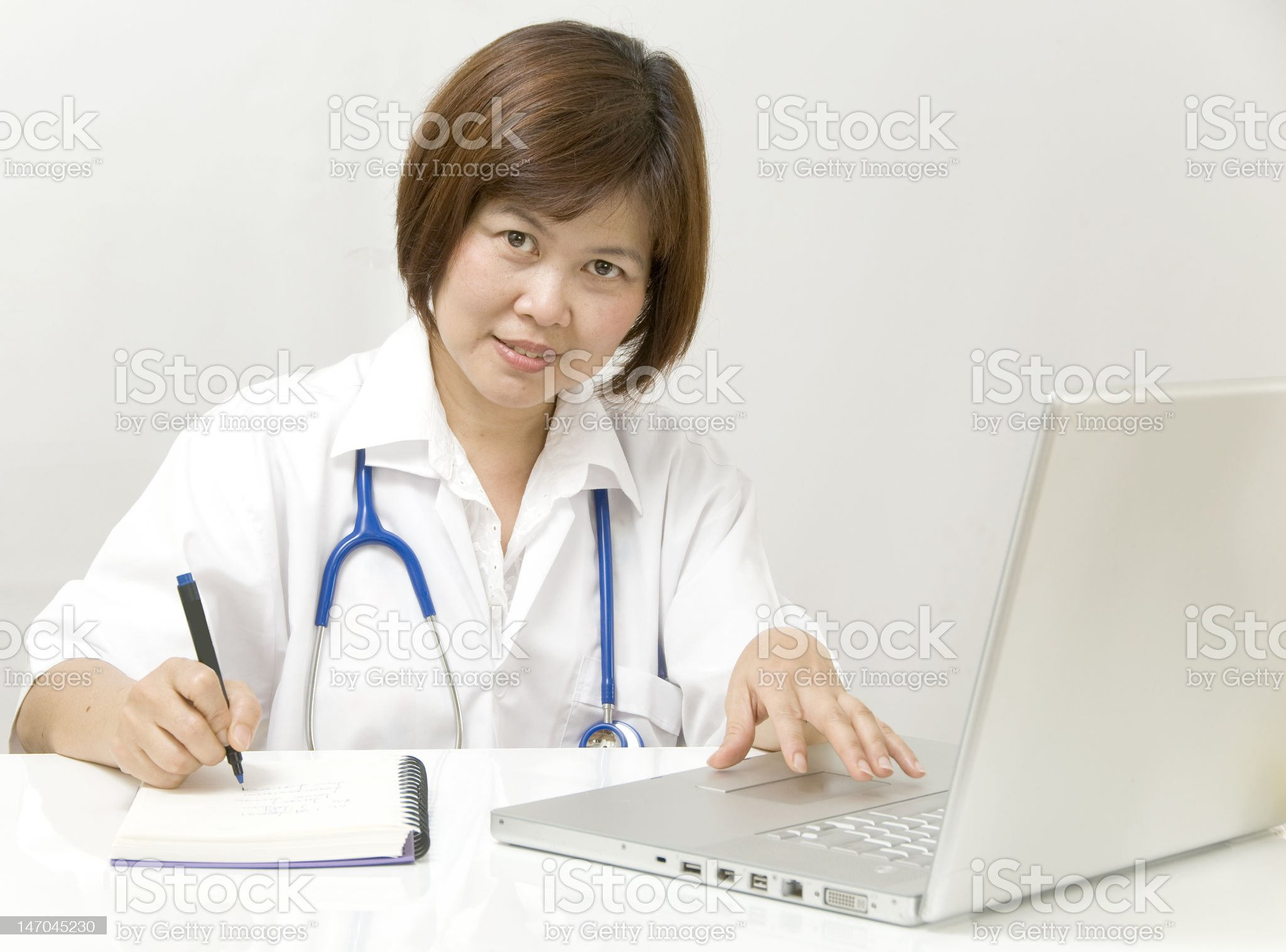 Physician at her desk royalty-free stock photo