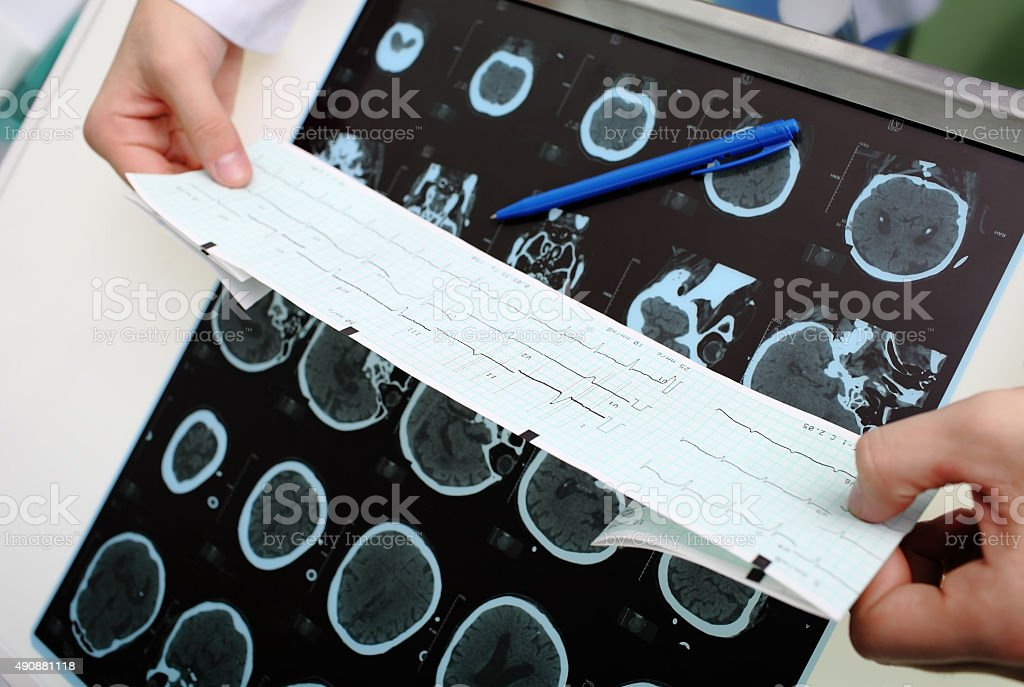 Physician examines the patient instrumental data stock photo