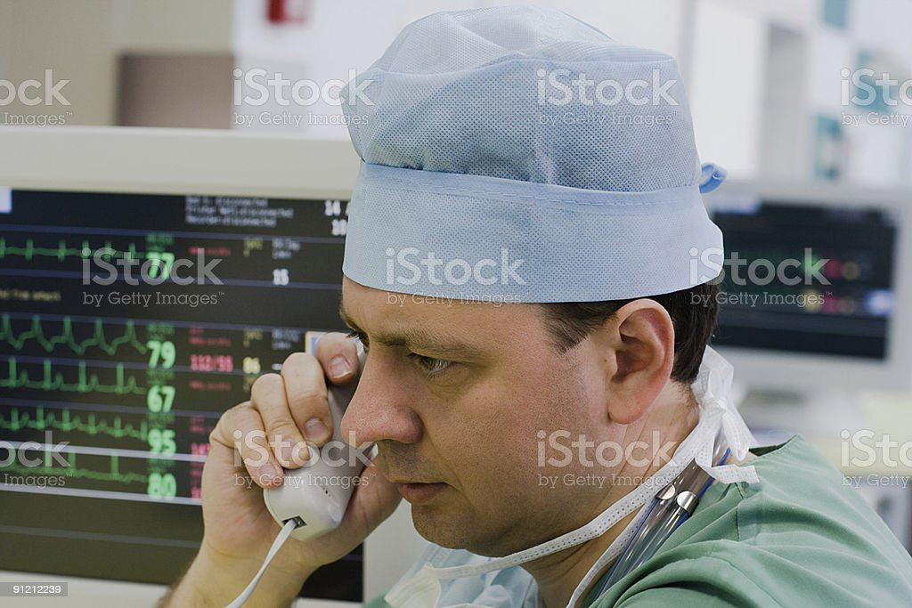 physician with phone in ICU royalty-free stock photo