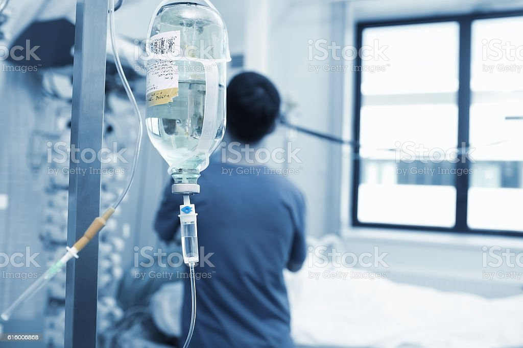 Physician works with critically ill patients stock photo