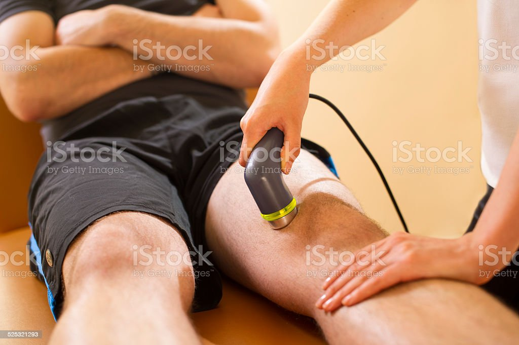 physio uses ultrasound on a sports injury stock photo