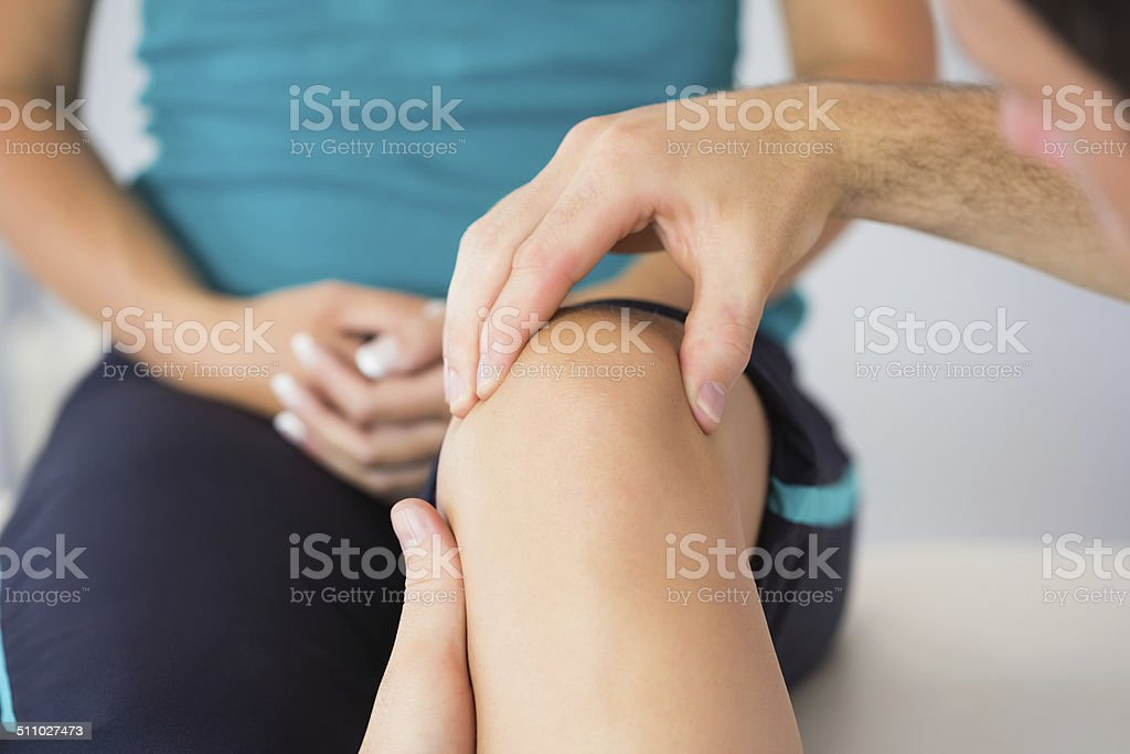 Physiotherapist controlling patients knee stock photo
