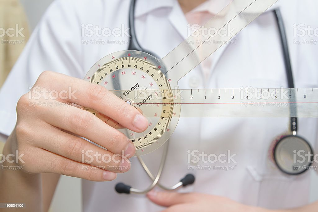 physiotherapist  holding  a goniometer for measuring range of mo stock photo