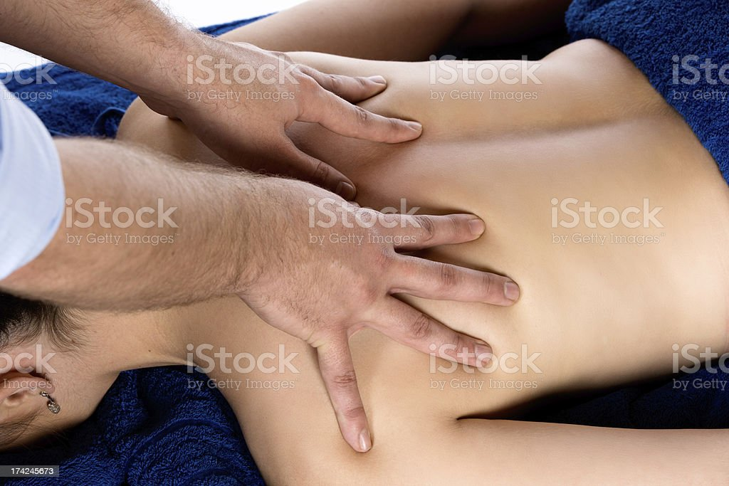 Physiotherapist massaging patient royalty-free stock photo