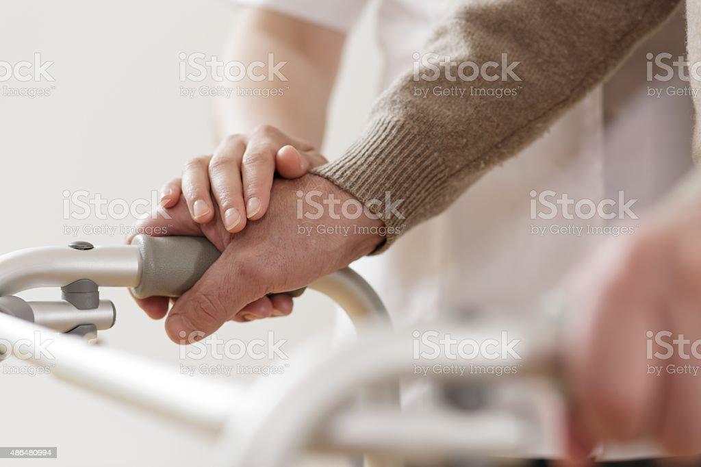 Physiotherapist supporting disabled man stock photo