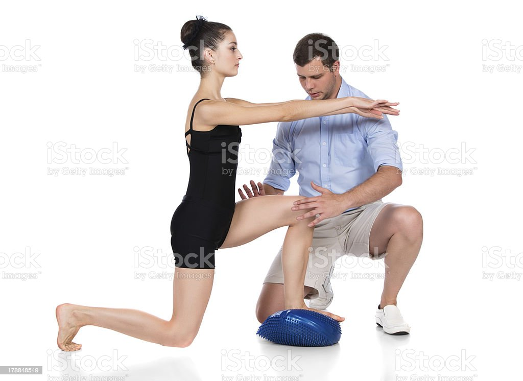 Physiotherapist treating patient royalty-free stock photo