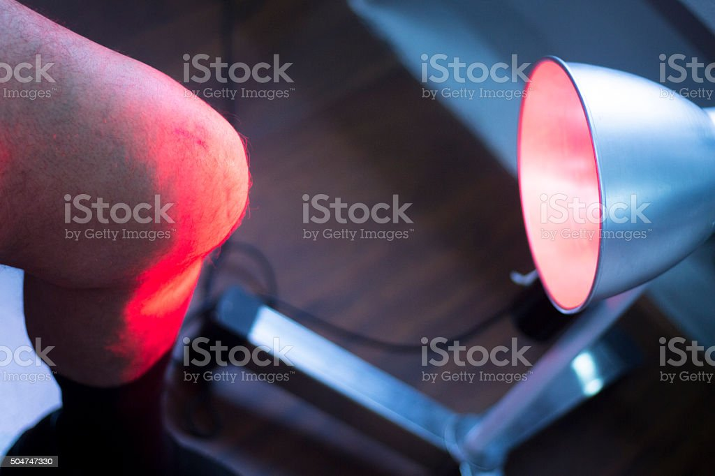 Physiotherapy clinic patient in heat treatment stock photo