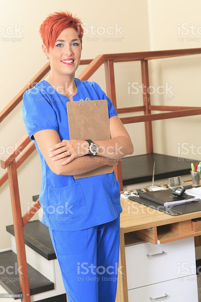 Physiotherapy - Employee Standing Vertical royalty-free stock photo