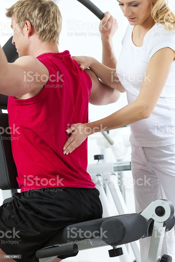 Physiotherapy patient with a trainer at physical therapy royalty-free stock photo