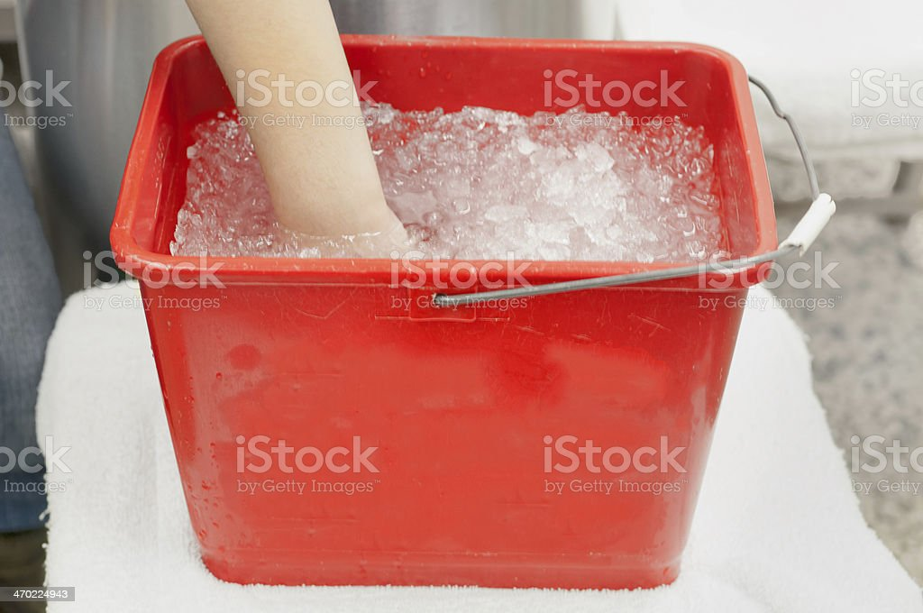 Physiotherapy Patient with Hand in Ice Bath stock photo