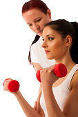 Physiotherapy - therapist doing arm  excercises with dumbbells