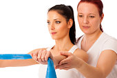 Physiotherapy - therapist doing arm strenghteninh excercises wit