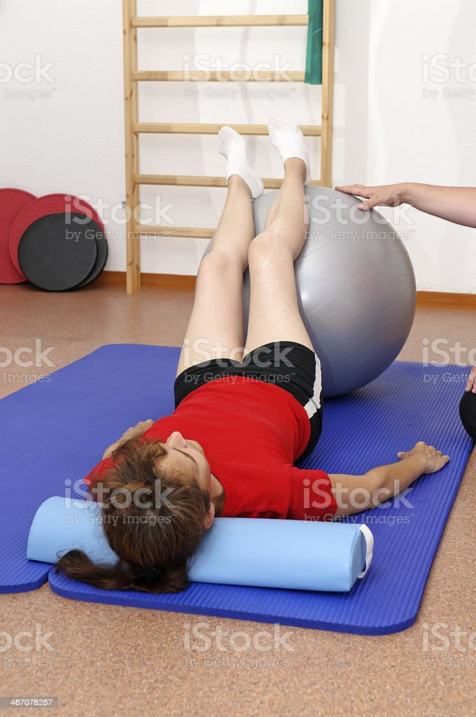 Physiotherapy with exercise ball stock photo