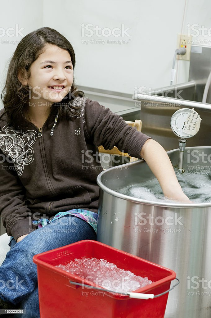 Physiotherapy, Young Girl with Hand in Hot Whirlpool Bath stock photo