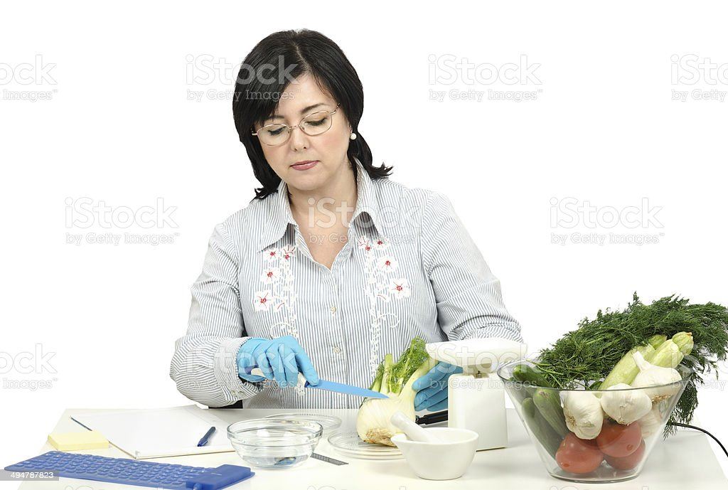 Phytocontrol technician intending to cut a fennel stock photo