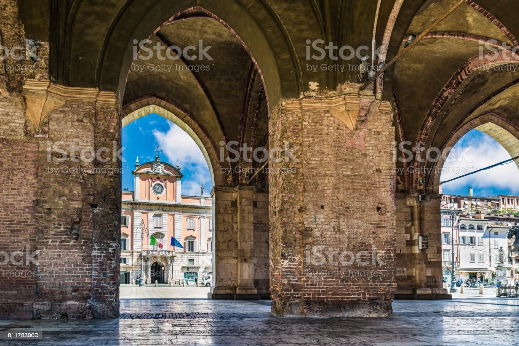 Piacenza, medieval town, Italy. Piazza Cavalli (Square horses) and Palazzo del Governatore  (Governor's palace) from the arcade of palazzo Gotico (Gothic palace) in the city center stock photo