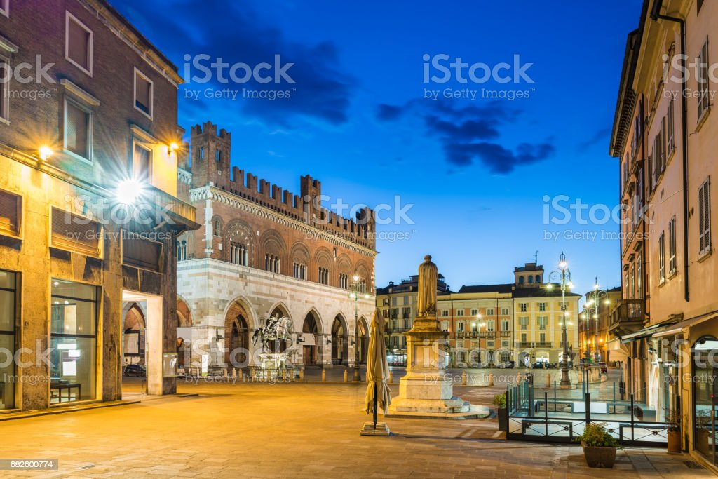 Piacenza, medieval town, Italy. Piazza Cavalli (Square horses) and palazzo Gotico (Gothic palace) in the city center on a beautiful day, at dusk. Emilia Romagna stock photo