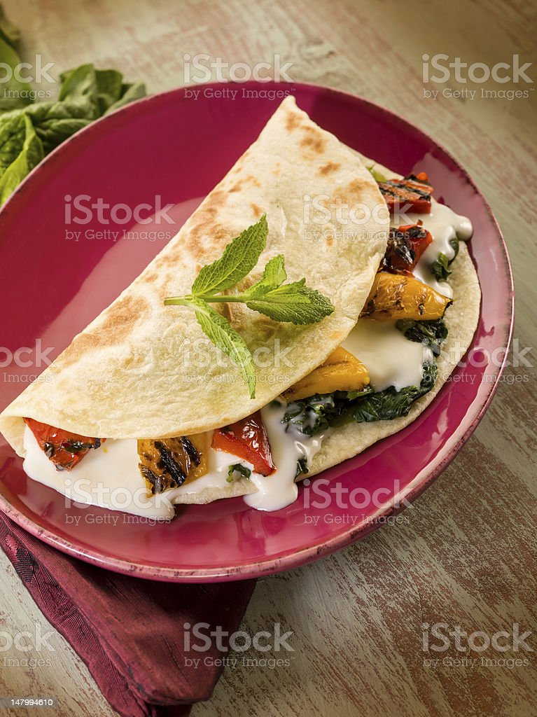 piadina with spinach grilled capsicum and cheese stock photo