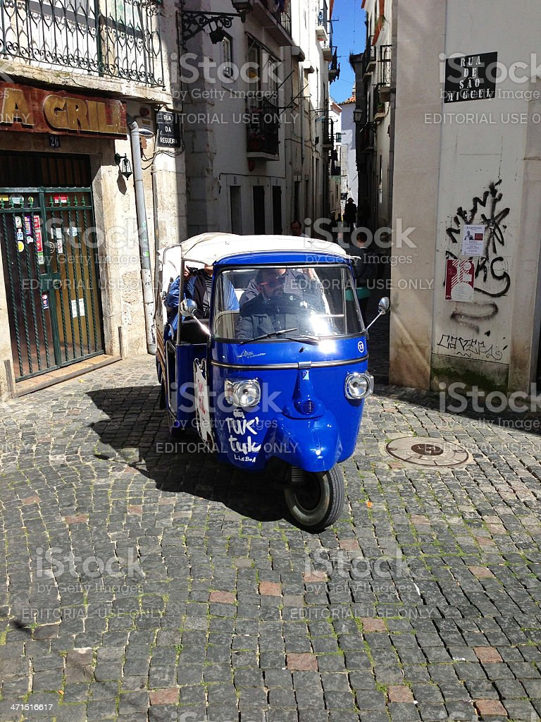 Piaggio Ape tourist bus in Lisbon royalty-free stock photo